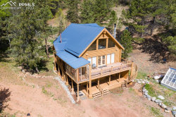 Photo of 7741 County Road 61, Divide, CO 80814 (MLS # 9275570)