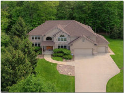 Photo of 6785 Ridgecliff Dr, Solon, OH 44139 (MLS # 4009479)