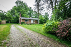 Photo of 9371 Ledge Acres Dr, Macedonia, OH 44056 (MLS # 4199901)