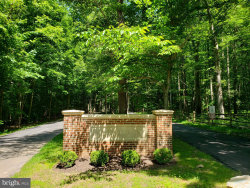 Photo of 7116 Sylvan Glen LANE, Fairfax Station, VA 22039 (MLS # VAFX746126)