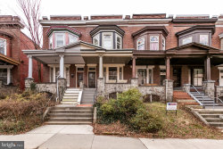 Photo of 309 E 33rd STREET, Baltimore, MD 21218 (MLS # MDBA496130)