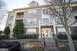 Photo of 8811 Stone Ridge CIRCLE, Unit 101, Baltimore, MD 21208 (MLS # MDBC514188)