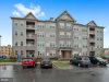 Photo of 5810 Burin STREET, Unit 204, New Market, MD 21774 (MLS # MDFR256016)