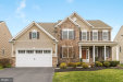 Photo of 10922 White Dahlia DRIVE, Woodstock, MD 21163 (MLS # MDHW260656)