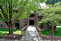 Photo of 18424 Guildberry DRIVE, Unit 304, Gaithersburg, MD 20879 (MLS # MDMC714714)