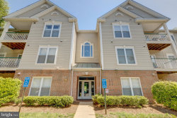 Photo of 6583 Grange LANE, Unit 202, Alexandria, VA 22315 (MLS # VAFX1063420)