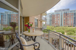 Photo of 11990 Market STREET, Unit 401, Reston, VA 20190 (MLS # VAFX1063578)