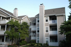 Photo of 14317 Climbing Rose WAY, Unit 203, Centreville, VA 20121 (MLS # VAFX1076774)