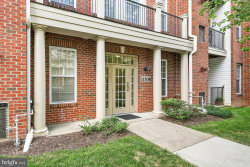 Photo of 11508 Sperrin CIRCLE, Unit 202, Fairfax, VA 22030 (MLS # VAFX1088496)