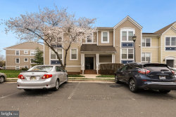 Photo of 20605 Cornstalk TERRACE, Unit 101, Ashburn, VA 20147 (MLS # VALO406836)