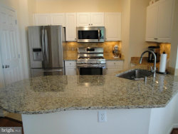 Photo of 1 Arch PLACE, Unit 221, Gaithersburg, MD 20878 (MLS # 1004463229)