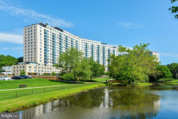 Photo of 10401 Grosvenor PLACE, Unit 1322, Rockville, MD 20852 (MLS # MDMC741228)