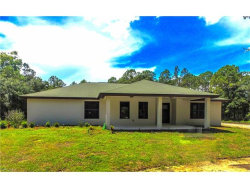 Photo of 8950 Henderson Grade RD, NORTH FORT MYERS, FL 33917 (MLS # 217056897)