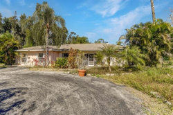 Photo of 6481 Quail Hollow LN, FORT MYERS, FL 33912 (MLS # 218014694)