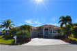 Photo of 8951 Timber Run CT, FORT MYERS, FL 33908 (MLS # 218033895)