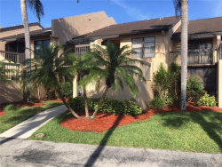 Photo of 15464 Admiralty CIR, Unit 8, NORTH FORT MYERS, FL 33917 (MLS # 218034883)