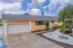 Photo of 725 Sturgeon PL, PUNTA GORDA, FL 33950 (MLS # 218040303)