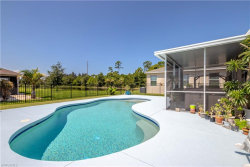 Photo of 10183 Winding River RD, PUNTA GORDA, FL 33950 (MLS # 218046628)