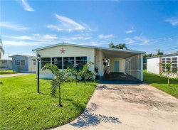 Photo of 128 Gaslight AVE, NORTH FORT MYERS, FL 33917 (MLS # 218047548)