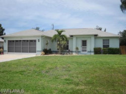 Photo of 3022 SW 14th AVE, CAPE CORAL, FL 33914 (MLS # 218048408)
