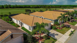 Photo of 10412 Materita DR, FORT MYERS, FL 33913 (MLS # 218053136)