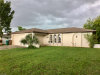 Photo of 3303 SW 1st AVE, CAPE CORAL, FL 33914 (MLS # 218054883)
