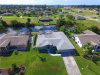 Photo of 700 SW 20th TER, CAPE CORAL, FL 33991 (MLS # 218069485)