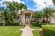 Photo of 14601 Headwater Bay LN, FORT MYERS, FL 33908 (MLS # 218076375)