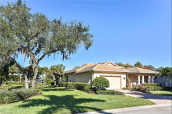 Photo of 13701 Woodhaven CIR, FORT MYERS, FL 33905 (MLS # 218080961)