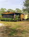 Photo of 8075 Hart DR, NORTH FORT MYERS, FL 33917 (MLS # 218082202)