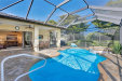 Photo of 8820 Tropical CT, FORT MYERS, FL 33908 (MLS # 219011450)