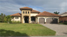 Photo of 1551 NW 28th AVE, CAPE CORAL, FL 33993 (MLS # 219015474)