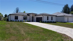 Photo of 920 SW 36th TER, CAPE CORAL, FL 33914 (MLS # 219030101)