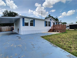 Photo of 7644 Peyraud DR, NORTH FORT MYERS, FL 33917 (MLS # 219033980)