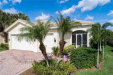 Photo of 10169 Mimosa Silk DR, FORT MYERS, FL 33913 (MLS # 219077384)