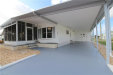 Photo of 3125 ORCHARD DR, NORTH FORT MYERS, FL 33917 (MLS # 219079247)