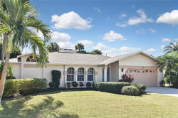 Photo of 9890 Country Oaks DR, FORT MYERS, FL 33967 (MLS # 219080456)