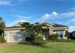 Photo of 13769 Woodhaven CIR, FORT MYERS, FL 33905 (MLS # 220080034)