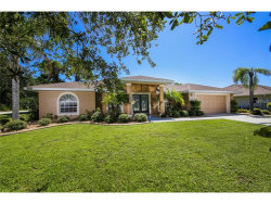 Photo of 10030 Jeansport Drive, ENGLEWOOD, FL 34224 (MLS # D5920054)