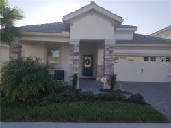 Photo of 1426 Pro Shop Court, CHAMPIONS GATE, FL 33896 (MLS # O5546060)