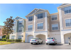 Photo of 12843 Madison Pointe Cir, Unit 302, ORLANDO, FL 32821 (MLS # O5548480)