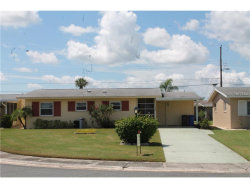 Photo of 1506 Chevy Chase Drive, SUN CITY CENTER, FL 33573 (MLS # T2886917)