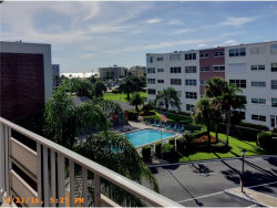 Photo of 5555 Gulf Boulevard, Unit 405, ST PETERSBURG BEACH, FL 33706 (MLS # U7789052)