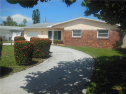 Photo of 10132 Paradise Boulevard, TREASURE ISLAND, FL 33706 (MLS # U7823097)