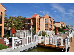 Photo of 8911 Blind Pass Road, Unit 101, ST PETE BEACH, FL 33706 (MLS # U7827574)