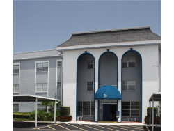 Photo of 1706 Belleair Forest Drive, Unit 238, BELLEAIR, FL 33756 (MLS # U7841044)