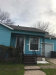 Photo of 812 E Cantey Street, Fort Worth, TX 76104 (MLS # 13985379)