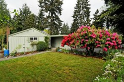 Photo of 15611 21st Ave SW, Seahurst, WA 98166 (MLS # 630271)