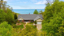 Photo of 11571 Lakeshore Drive, Grand Haven, MI 49417 (MLS # 20017977)