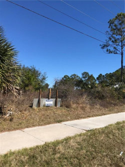 Photo of PROWESS (BACKS UP TO PRICE BLVD) CT, NORTH PORT, FL 34288 (MLS # D5920393)